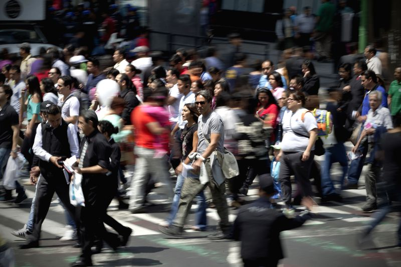 Residents walk on the eve of the commemoration of the International Pedestrian Day, in Mexico City, capital of Mexico, on Aug. 16, 2014. The International ...