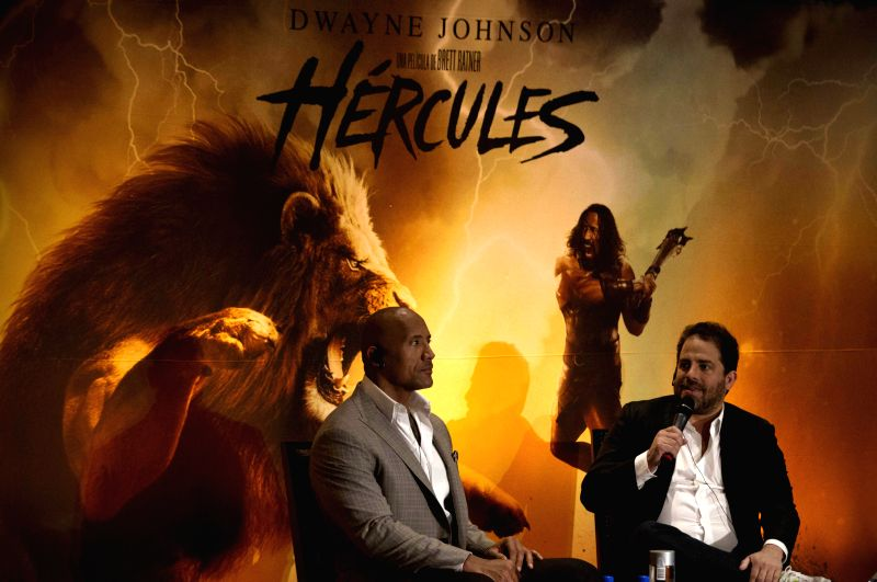 """U.S. actor Dwayne Johnson (L), or """"The Rock"""", and U.S. director Brett Ratner take part in a press conference to promote their new movie Hercules in ..."""