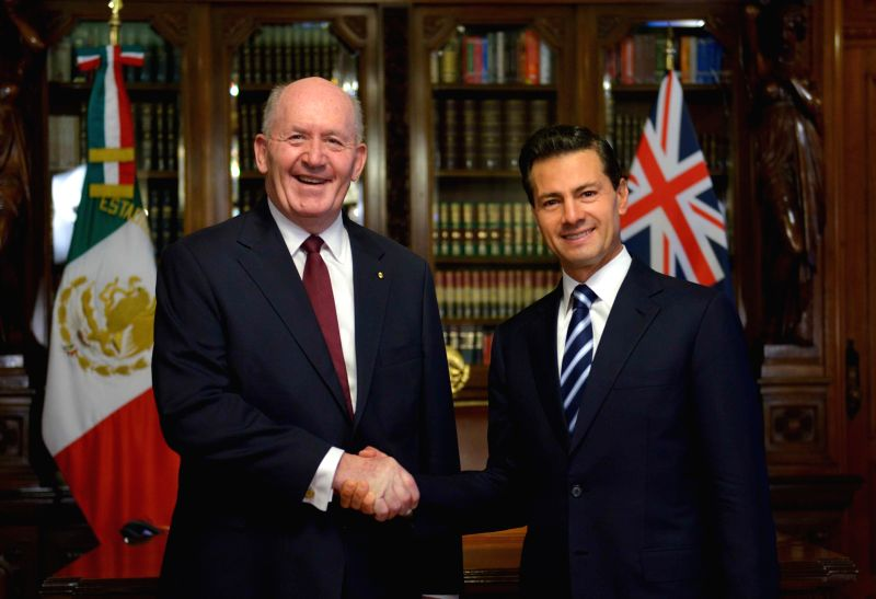 MEXICO CITY, Aug. 2, 2016 - Photo provided by the Mexican Presidency shows Mexican President Enrique Pena Nieto (R) shaking hands with Governor-General of Australia Peter Cosgrove at the National ...