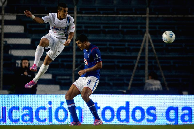 Cruz Azul's Francisco Javier Rodriguez (R) vies for the ball with Camilo da Silva of Queretaro during their match of the MX League Opening Tournament held at ...