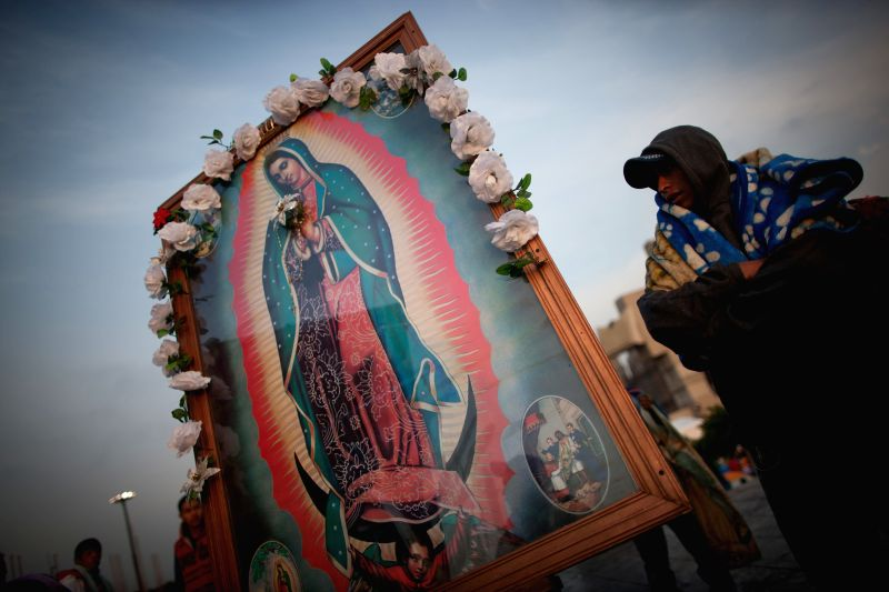 A poster of the Virgin of Guadalupe is seen at the atrium of Basilica of Guadalupe during an event marking Our Lady of Guadalupe Day in Mexico City, Mexico, on .