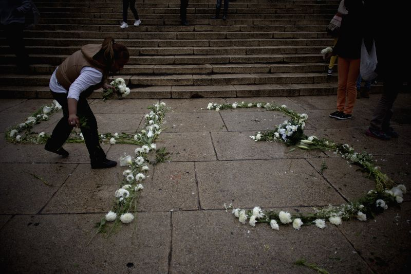 "A woman takes part in the ""public prayer for justice and peace in Mexico"", in support of the 43 students of the Normal Rural School of Ayotzinapa that"