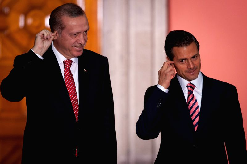 Mexico's President Enrique Pena Nieto (R) and his Turkish counterpart Recep Tayyip Erdogan react during a signing ceremony of agreements held at National Palace