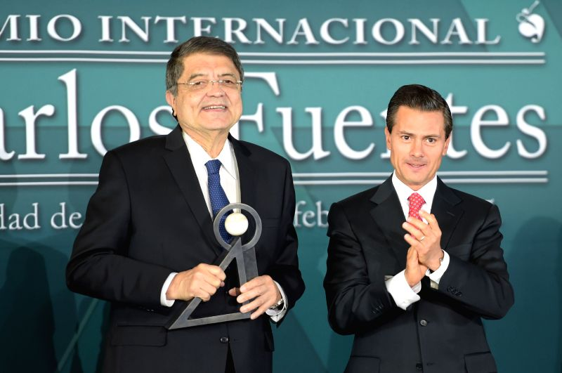 Image provided by Mexico's Presidency shows Mexican President Enrique Pena Nieto (R) and Nicaragua's writer Sergio Ramirez attending the awarding ceremony of ...