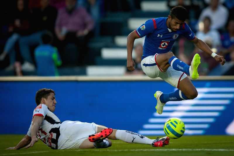 Cruz Azul's Joao Rojas (R), vies the ball with Monterrey's Hiram Mier, during a match of the 2015 Closing Tournament of MX League in the Azul Stadium, in Mexico .