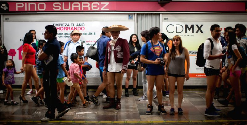 "Residents participate in the event ""Travel Without Pants in the Subway"" in Mexico City, capital of Mexico, on Jan. 11, 2015.  (Xinhua/Pedro Mera) ..."