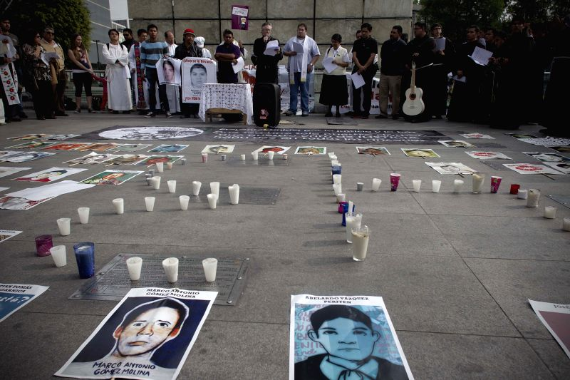 "Residents and family members take part in a mass for 43 missing students of the Normal Rural School Raul Isidro Burgos of Ayotzinapa, called ""A Light For .."