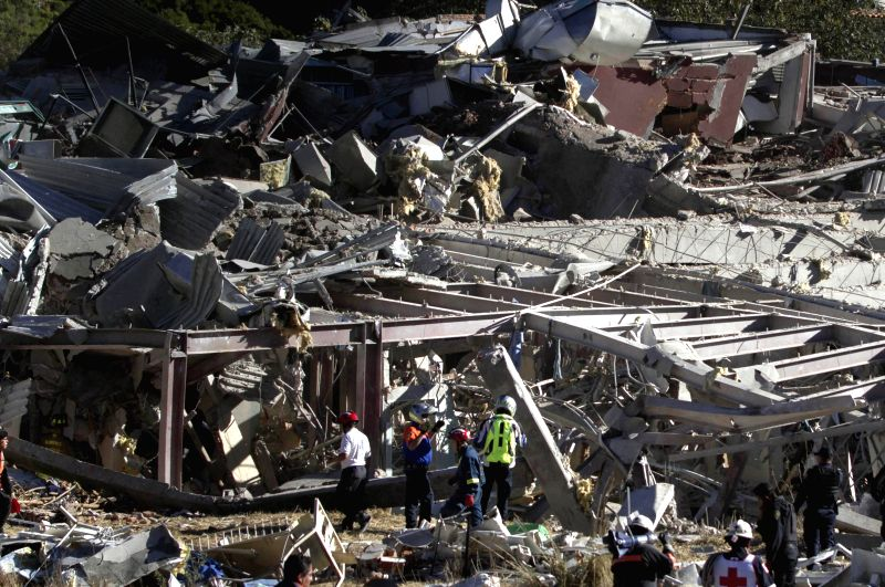 Rescuers work at the site where a tanker truck that was supplying gas in front of a hospital exploded, in Mexico City, capital of Mexico, on Jan. 29, 2015. At ..