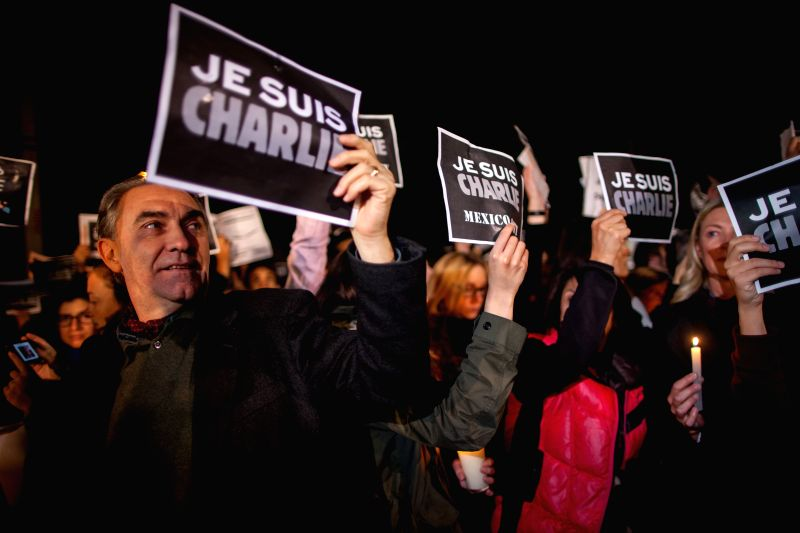 """People take part in a protest against the attack on French satirical weekly """"Charlie Hebdo"""" in Paris, in front of the French Ambassy in Mexico City, ..."""
