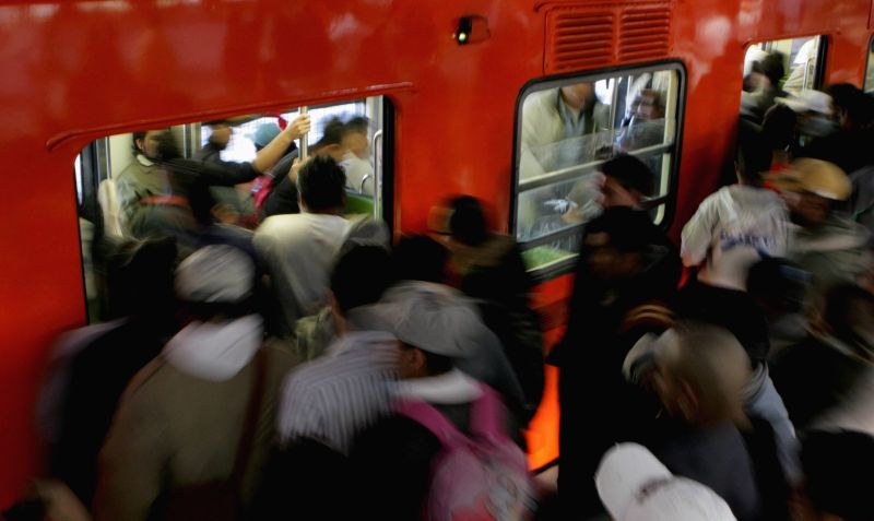 People  flood into a subway train in Mexico City, capital of Mexico, on July 10, 2014. The World Population Day is observed on July 11 every year to raise ...