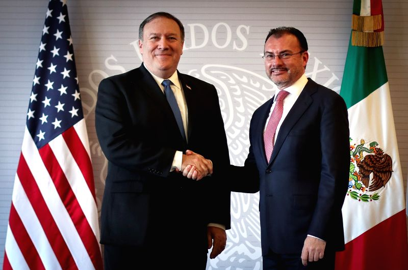 MEXICO CITY, July 14, 2018 - Mexican Foreign Secretary Luis Videgaray (R) shakes hands with U.S. Secretary of State Mike Pompeo after their meeting in Mexico City, capital of Mexico, on July 13, 2018.