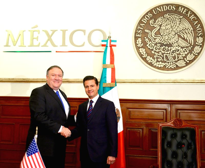 MEXICO CITY, July 14, 2018 - Photo provided by Mexico's Presidency shows sitting Mexican President Enrique Pena Nieto (R) shaking hands with U.S. Secretary of State Mike Pompeo during their meeting ...