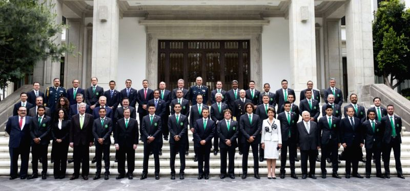 Image provided by Mexico's Presidency shows Mexican President Enrique Pena Nieto (C, front) posing with State Secretaries, and technical and directive staff and