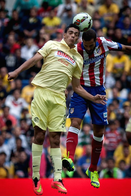 America's Raul Jimenez (L) vies for the ball with Mario Suarez  (R) of Atletico de Madrid, during their match of the EuroAmerican Cup held at Azteca Stadium in .