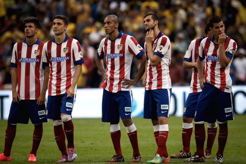 Players of Atletico de Madrid react after the match of the EuroAmerican Cup against America held at Azteca Stadium in Mexico City, capital of Mexico, on July ..