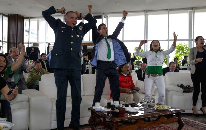 This image provided by Mexico's Presidency on June 23, 2014 shows Mexican President Enrique Pena Nieto (2nd L) and National Defense Secretary Salvador ...