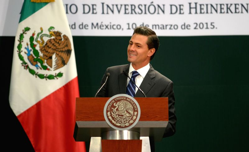 Image provided by Mexico's Presidency shows Mexican President Enrique Pena Nieto offering a speech during the announcement on the investment of the brewery ...