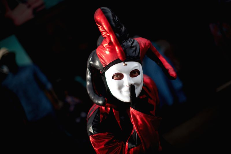 A harlequin reacts during the 2015 Ibero-American Musical Culture Festival Vive Latino, at Foro Sol, in Mexico City, capital of Mexico, on March 14, 2015. The ...