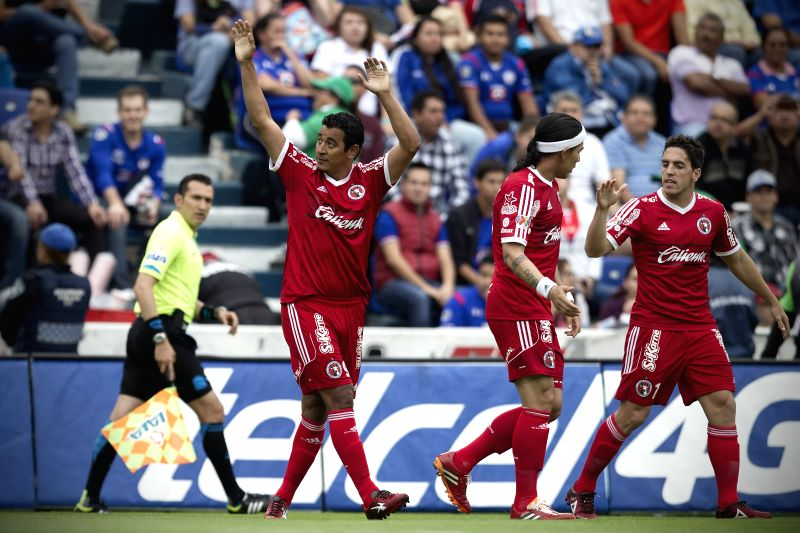 Alfredo Moreno (L) of Xolos celebrates his scoring during the match of 2015 Closing Tournament of MX League against Cruz Azul, in the Azul Stadium, in Mexico ...