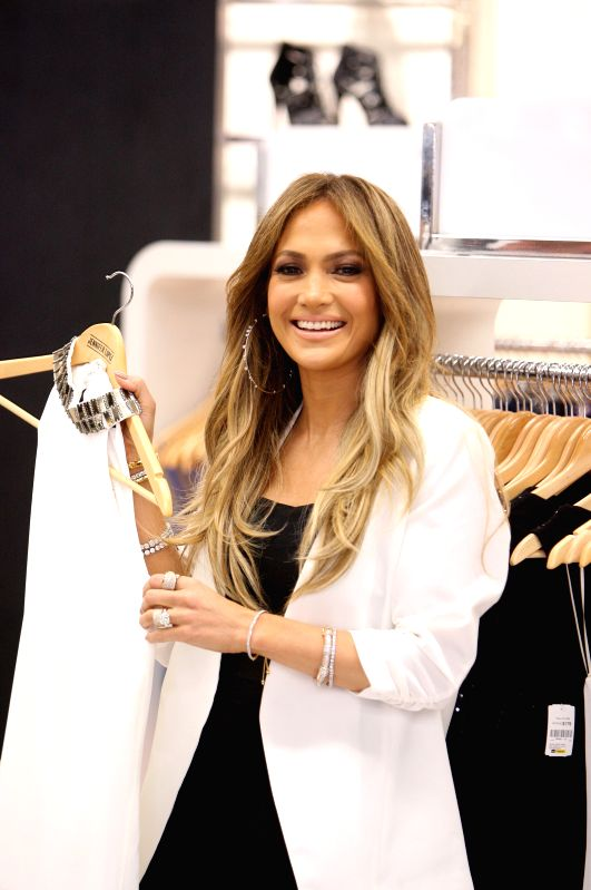 American singer Jennifer Lopez shows garments during the presentation of her clothing line, in a department store, in Mexico City, capital of Mexico, on March ...