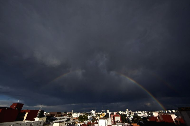 Two rainbows appear simultaneously after a rainfall in Mexico City, capital of Mexico, on March 25, 2015.