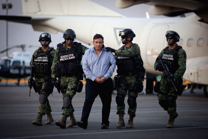 Mexican Army personnel escort Omar Trevino Morales (C) in Mexico City, capital of Mexico, on March 4, 2015. Mexican authorities on Wednesday arrested the head ...