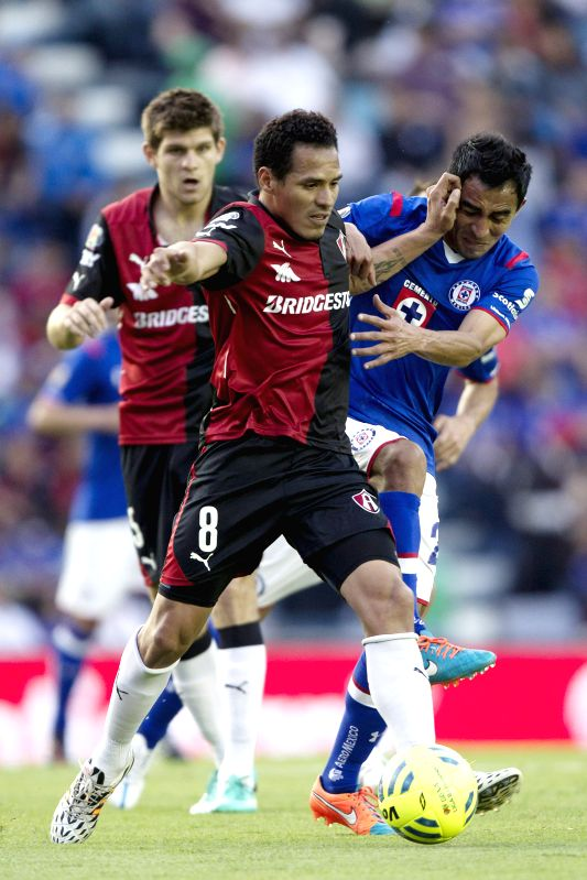 Cruz Azul's Rafael Baca (R) vies the ball with Atlas' Aldo Ramirez during the match of the 2015 Closing Tournament of MX League in the Azul Stadium in Mexico ...