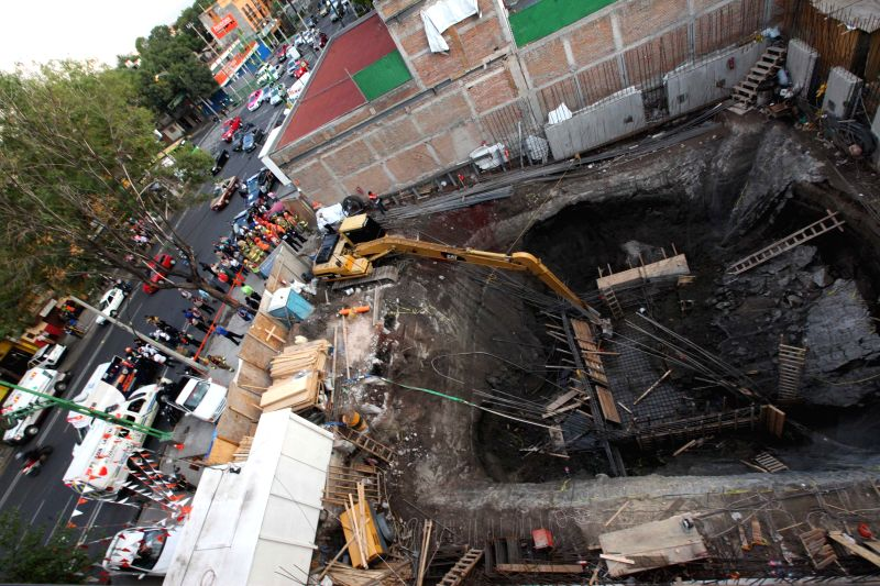 Photo taken on April 30, 2015 shows a collapsed construction site in Mexico City, capital of Mexico. According to the local press, at least five persons were ...