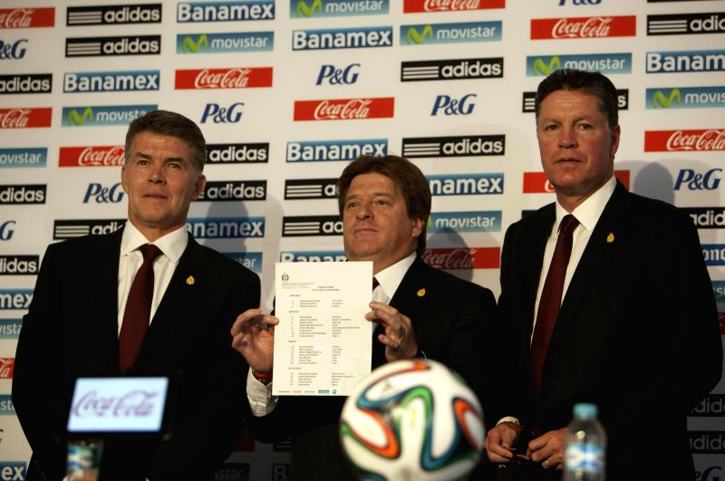 MEXICO CITY, May, 10, 2014 Coach of Mexico's national soccer team Miguel Herrera (C), Director for National Teams, Hector Gonzalez Inarritu (L), and Sports Director Ricardo Pelaez (R), ...