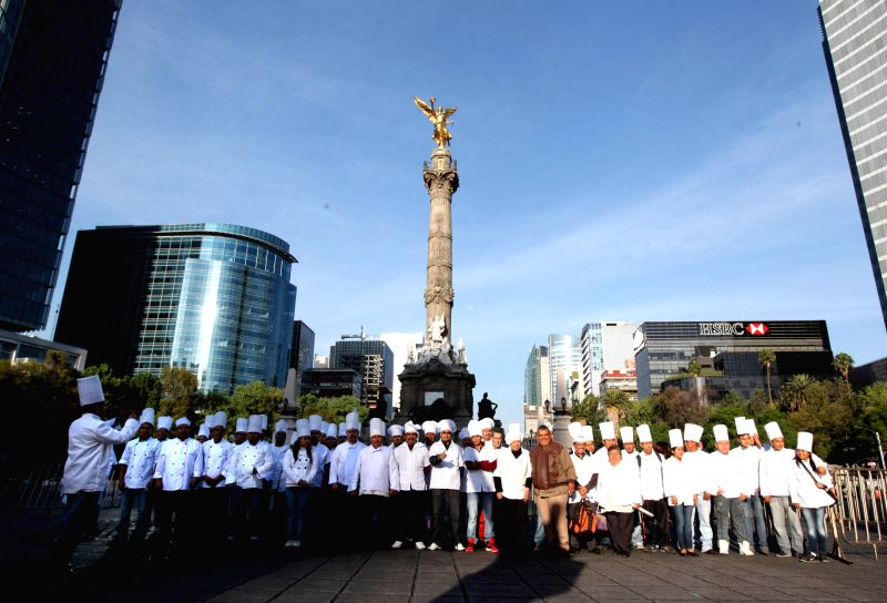 Chefs pose during the Chef's Festival in Mexico City, capital of Mexico, on May 17, 2014. During the festival, two Guinness World Records were broken, one for ...