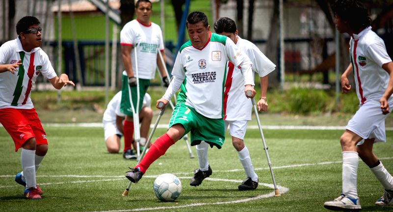 Image taken on May 17, 2014 shows a player of the team Guerreros Aztecas del Distrito Federal of amputees soccer, vies for the ball during a friendly match, in ..