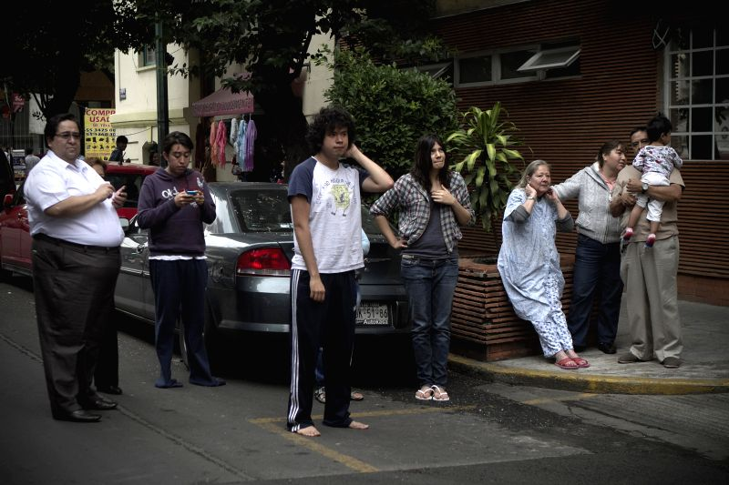 Photo: Residents remain in the street after an earthquake in Mexico City, capital of Mexico, on May 8, 2014. A strong earthquake jolted southwest Mexico on ...