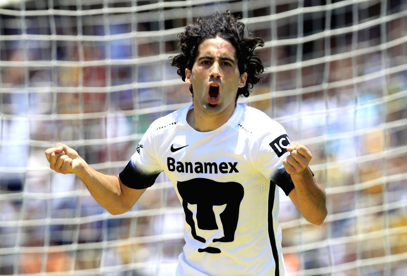 MEXICO CITY, May 9, 2016 - UNAM's Pumas Matias Britos celebrates his score in the match of Day 17 of 2016 Closing Tournament of MX League against America, at Olympic University Stadium, in Mexico ...