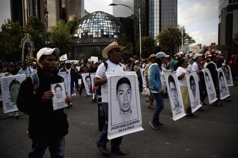 Mexico City (Mexico ): Family members of the 43 students of the Normal Rural School of Ayotzinapa that went missing in Iguala, Guerrero, take part in a protest in Mexico City, capital of Mexico, on ..