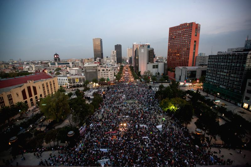 Mexico City (Mexico ): Residents take part in a protest for the 43 students of the Normal Rural School of Ayotzinapa that went missing in Iguala, Guerrero, in Mexico City, capital of Mexico, on Dec. .