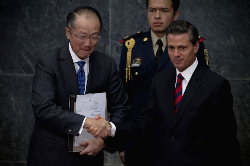 Mexico City: Mexico's President Enrique Pena Nieto (R) shakes hands with Word Bank President Jim Yong Kim (L) during an event to announce World Bank support for Mexico's Prospera social net program ..