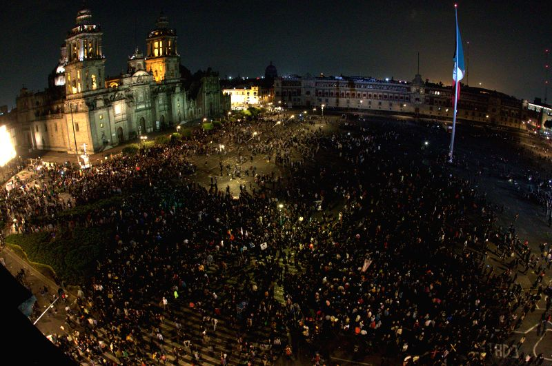Mexico City: People take part in a demonstration calling for the safe return of the 43 missing students of the Raul Isidro Burgos Rural Teachers' College of Ayotzinapa, in Mexico City, capital of ...