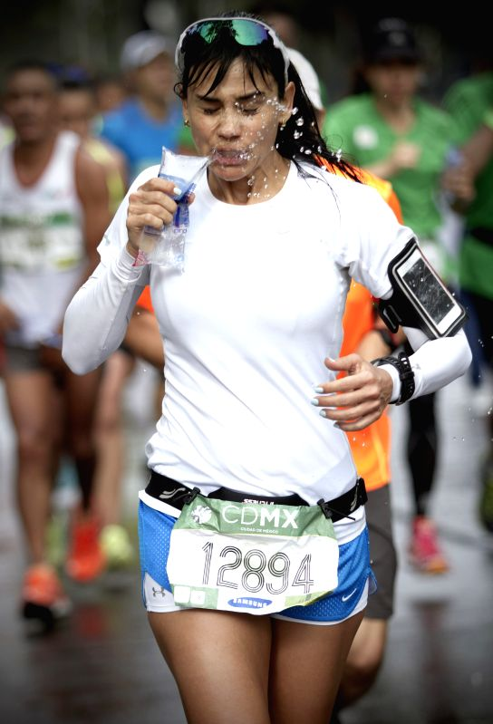 A runner attends the 32nd edition of the 2014 Mexico City Marathon, in Mexico City, capital of Mexico on Aug. 31, 2014.