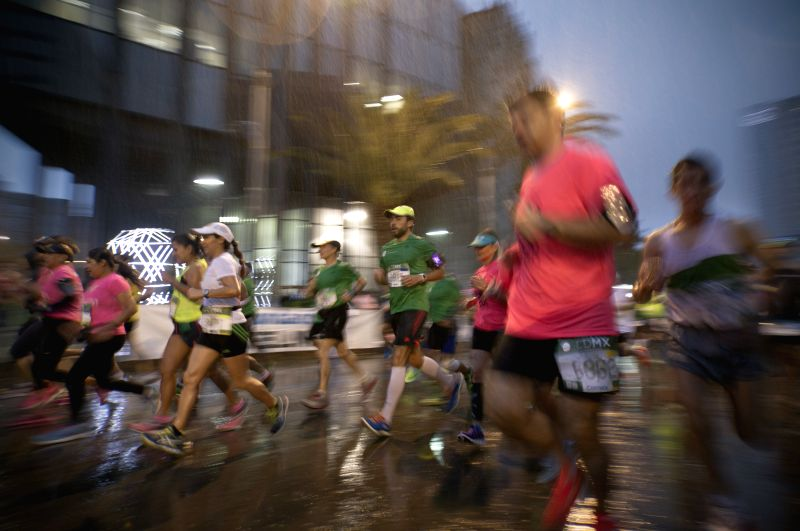 Runners take part in the 32nd edition of the 2014 Mexico City Marathon, in Mexico City, capital of Mexico on Aug. 31, 2014.