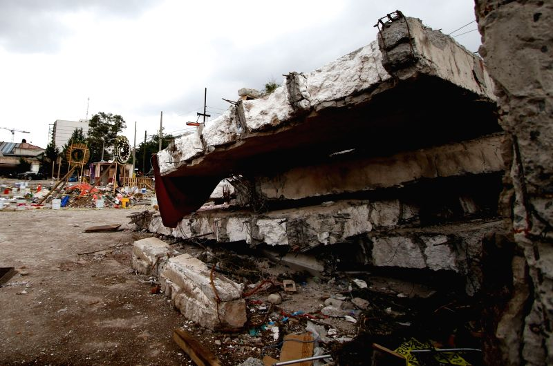 MEXICO CITY, Sept. 30, 2017 - Photo taken on Sept. 29, 2017 shows a view of debris of a building that collapsed after the earthquake of Sept. 19, in Mexico City, capital of Mexico, on Sept. 29, 2017. ...