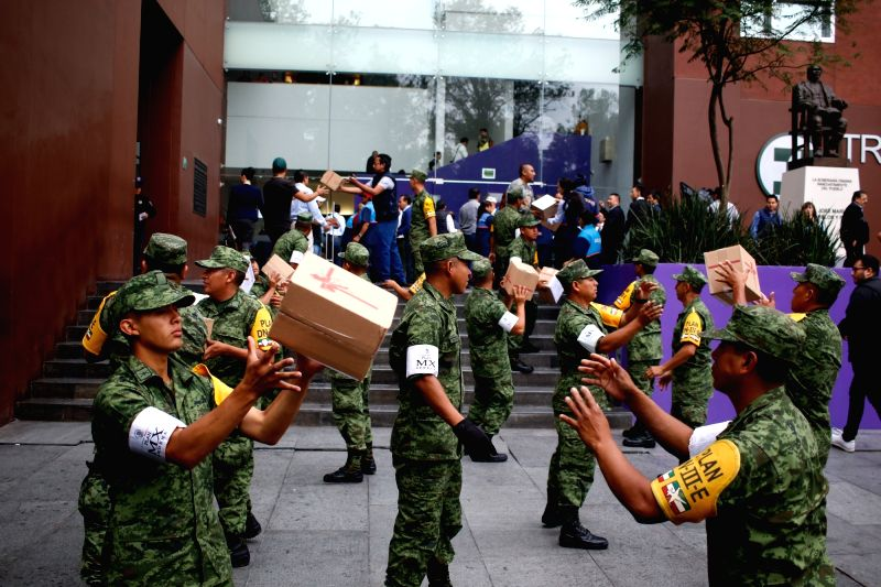 MEXICO CITY, Sept. 30, 2017 - Soldiers carry supplies donated by Chinese trade associations, in Mexico City, capital of Mexico, Sept. 29, 2017. Chinese trade associations in Mexico on Friday donated ...