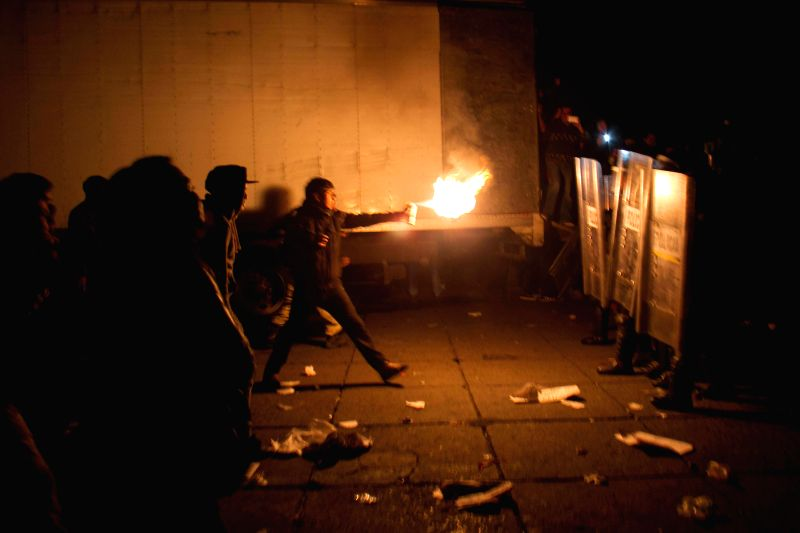 Mexico City: Young men clash with riot police during a demonstration calling for the safe return of the 43 missing students of the Raul Isidro Burgos Rural Teachers' College of Ayotzinapa, in Mexico .