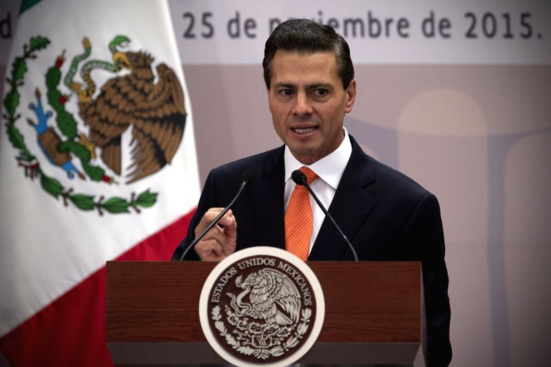 Mexico's President Enrique Pena Nieto delivers a speech during an event commemorating the International Day for the Elimination of Violence against Women in ...