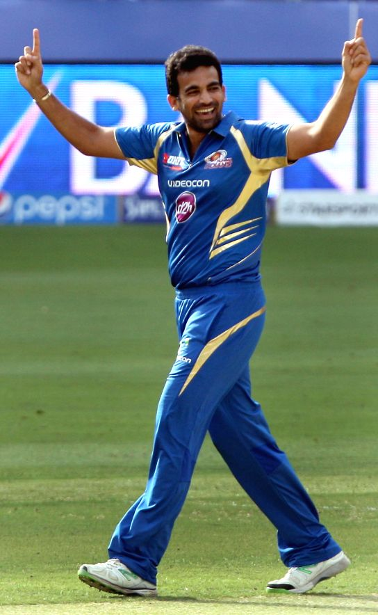 MI bowler Lasith Malinga celebrates fall of a wicket during the fifth match of IPL 2014 between Royal Challengers Bangalore and Mumbai Indians, played at Dubai International Cricket Stadium in Dubai . - Lasith Malinga