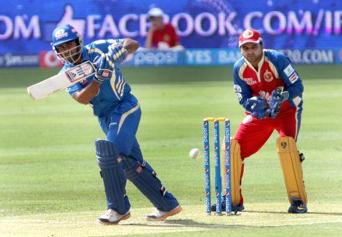 MI bowler Zaheer Khan celebrates fall of a wicket during the fifth match of IPL 2014 between Royal Challengers Bangalore and Mumbai Indians, played at Dubai International Cricket Stadium in Dubai of . - Zaheer Khan