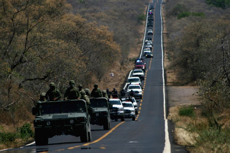 Military personnel escort 44 alleged members of Jalisco New Generation Cartel (CJNG, for its acronym in Spanish) that infiltrated as self-defense forces in ...