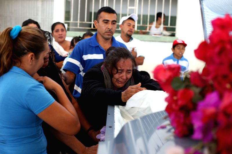 Agapita Montes Rivera (C), mother of Antonio Zambrano, a Mexican migrant who died in the U.S., reacts in front of her son's coffin during the funeral, in Pomaro ...