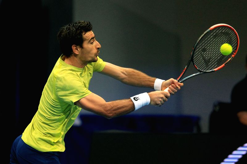 Micromax Indian Aces' player Ivan Dodig of Croatia returns the ball against players of Obi UAE Royals during their men's doubles match in the International ...