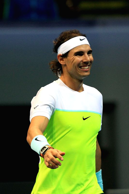 Micromax Indian Aces' player Rafael Nadal of Spain smiles during the men's doubles match against Obi UAE Royals in the International Premier Tennis League (IPTL) ...