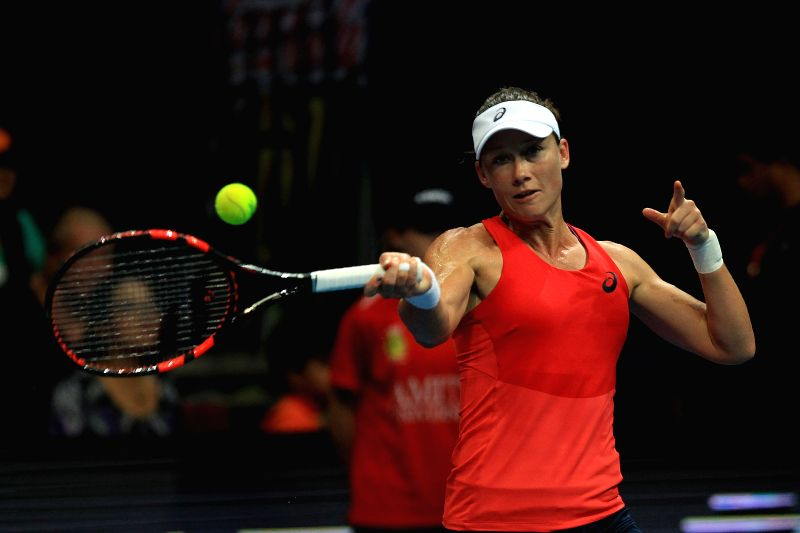 Micromax Indian Aces' player Samantha Stosur of Australia returns the ball to Obi UAE Royals' player Ana Ivanovic of Serbia during their match in the ...